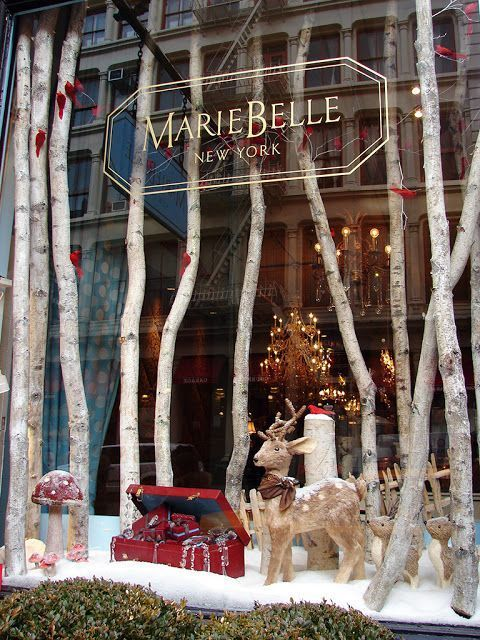 Marie Belle's warm and inviting New York winter window:​